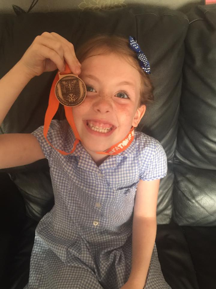 Florence with her medal x